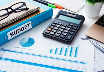 Financial and budget planning concept with calculator  notebook and financial chart report on work desk